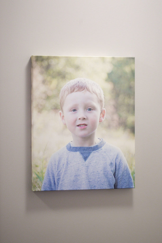 a photo of a wall canvas of a little boy