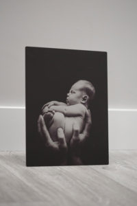 photo of a metal art print of a newborn boy