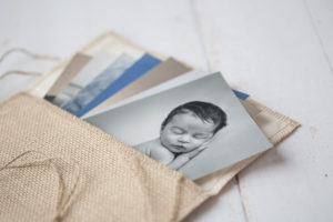 a photo of prints in a burlap pouch