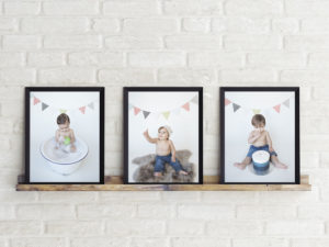a series of photos in frames on a wood ledge