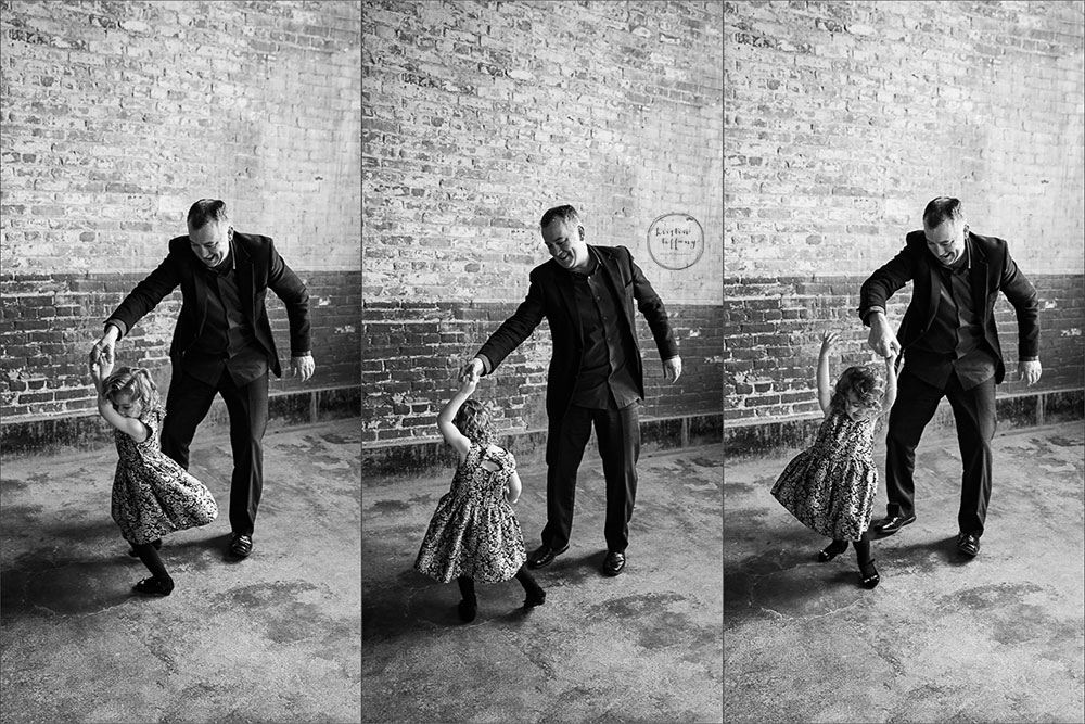 a photo of a dad twirling his daughter