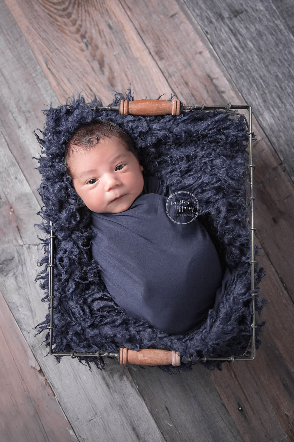 a photo of a baby boy in a wire basket