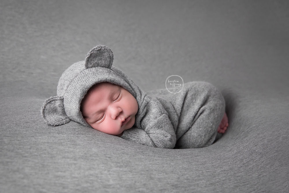 a photo from a newborn photo session with a baby boy