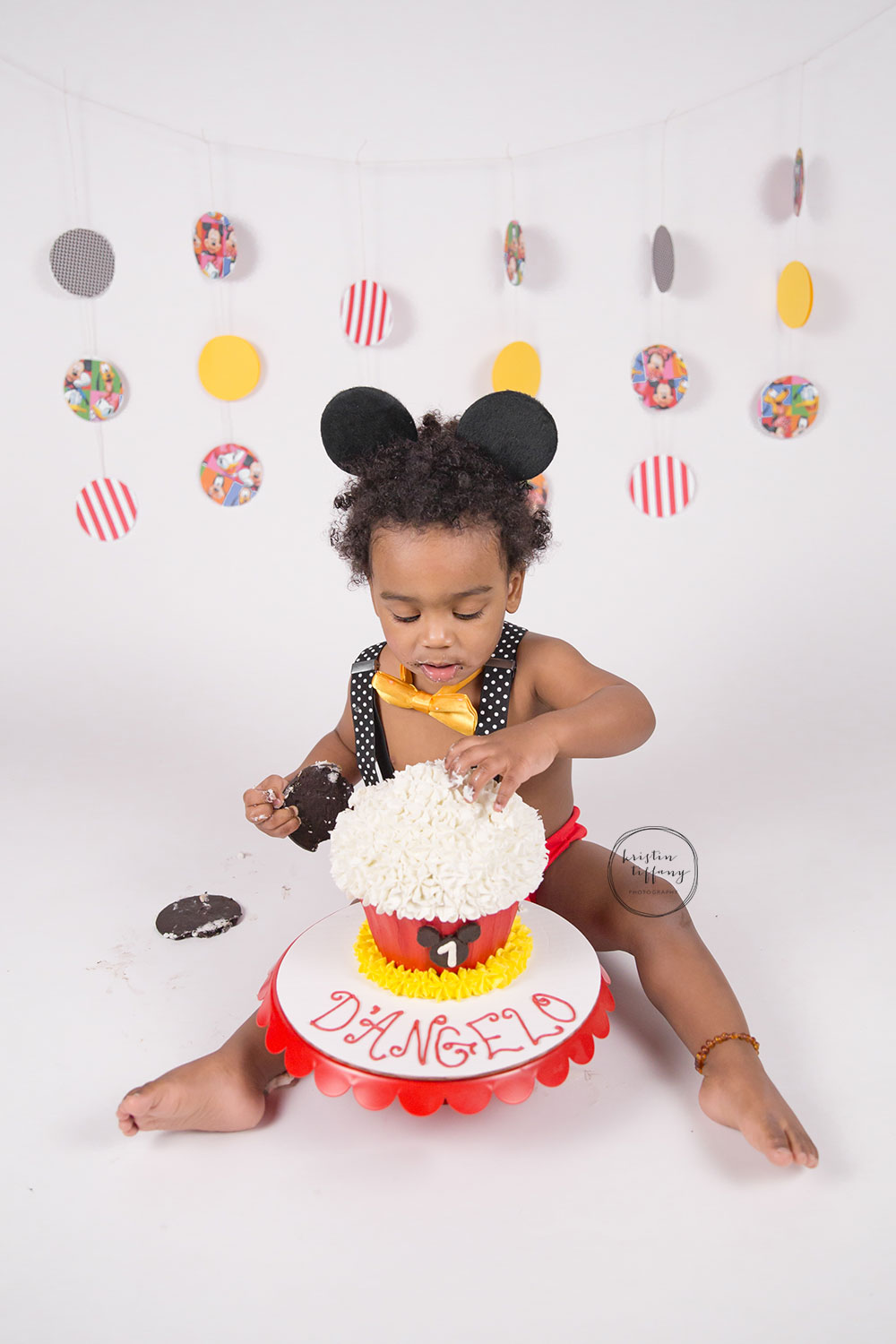 a photo from a Mickey Mouse themed cake smash