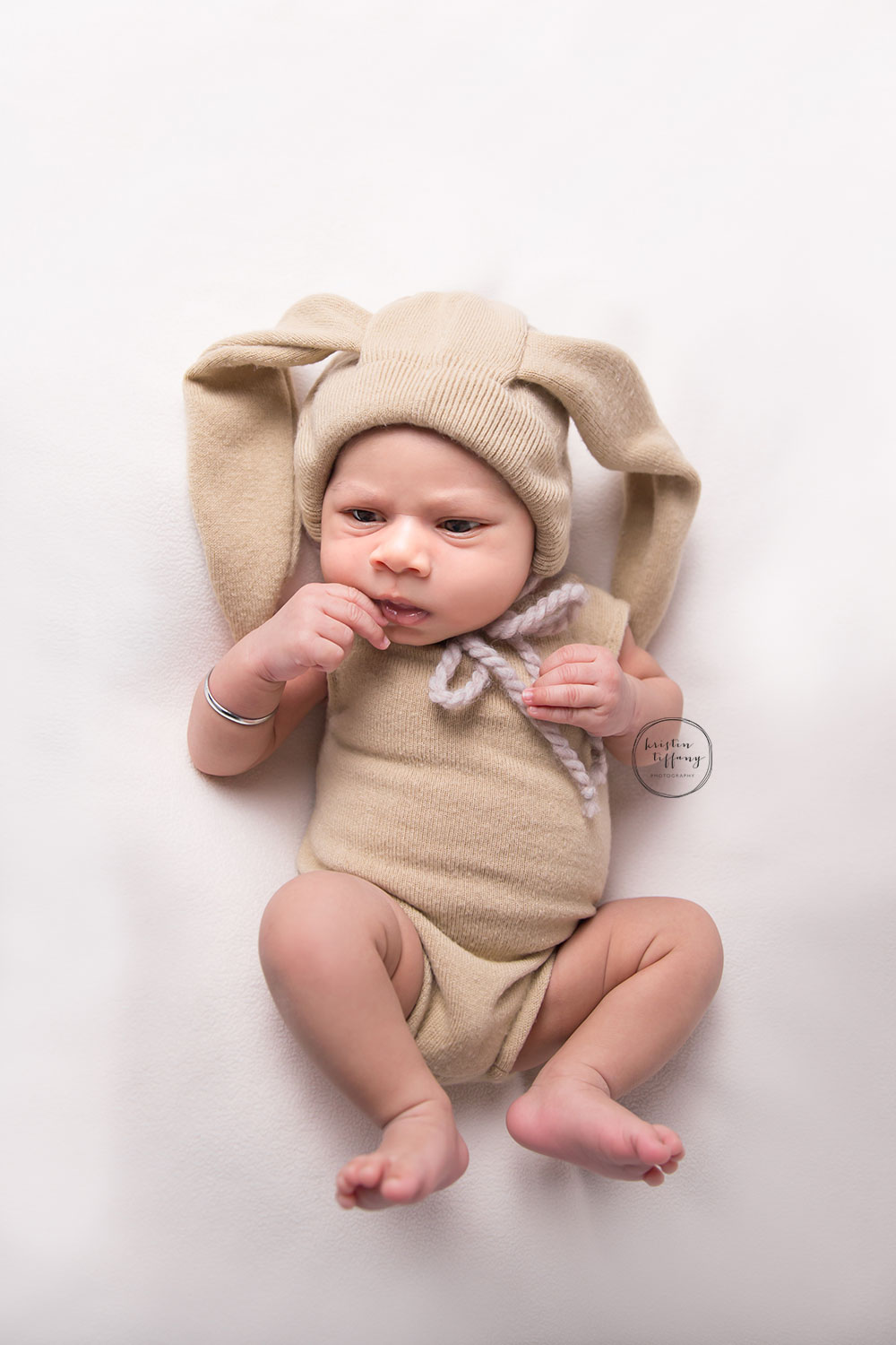 a photo of a baby wearing a bunny outfit
