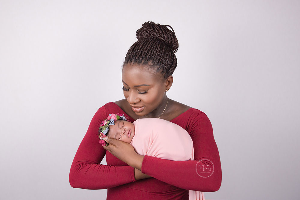 a photo of a newborn baby girl and her mom at a posed newborn session