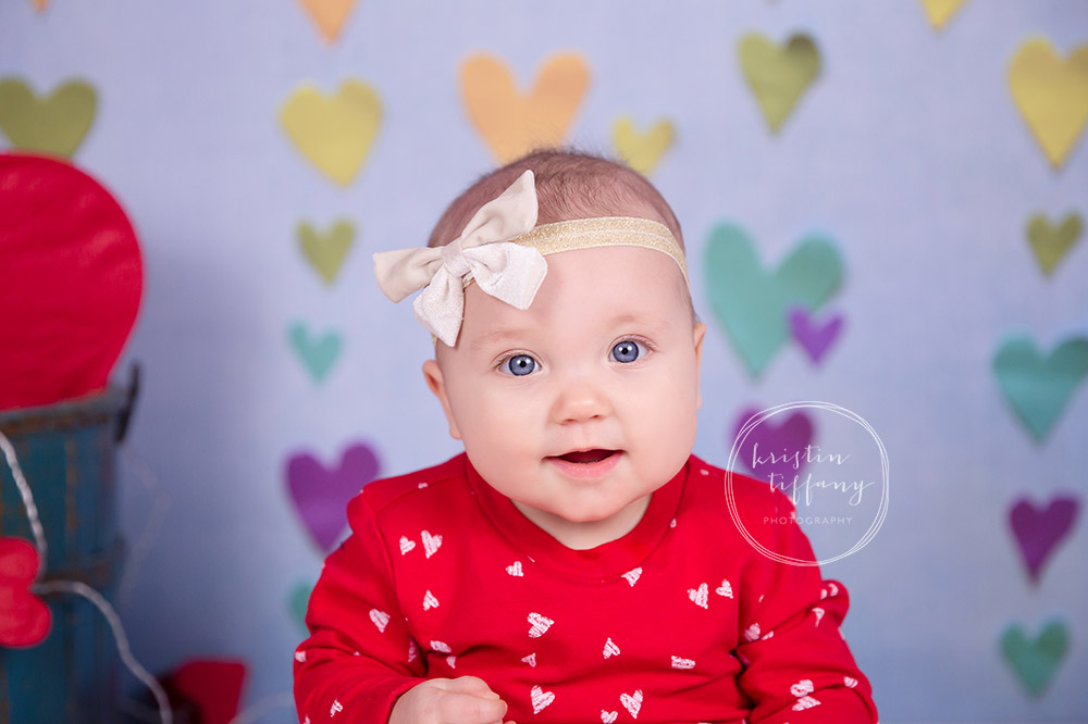 a photo of a baby girl at a valentines photoshoot