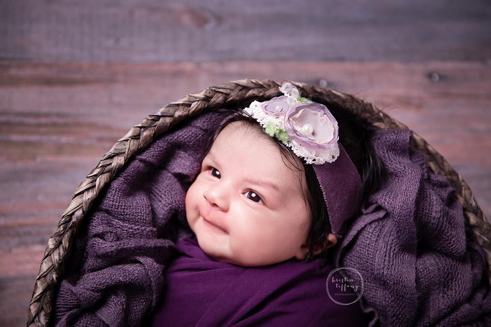 a photo of a smiling newborn