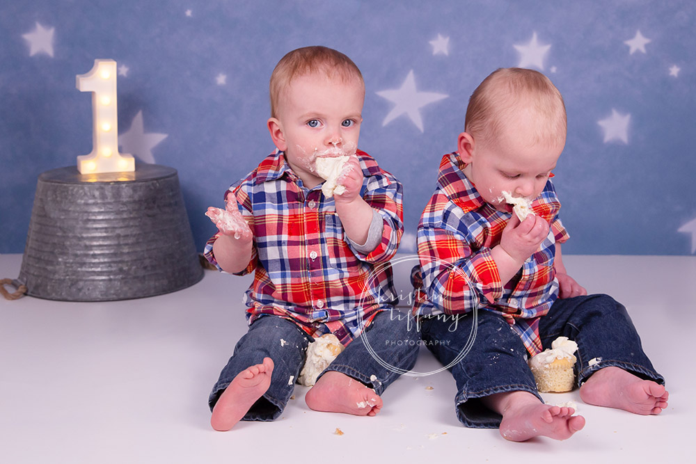 a photo of twin boys at a cake smash session