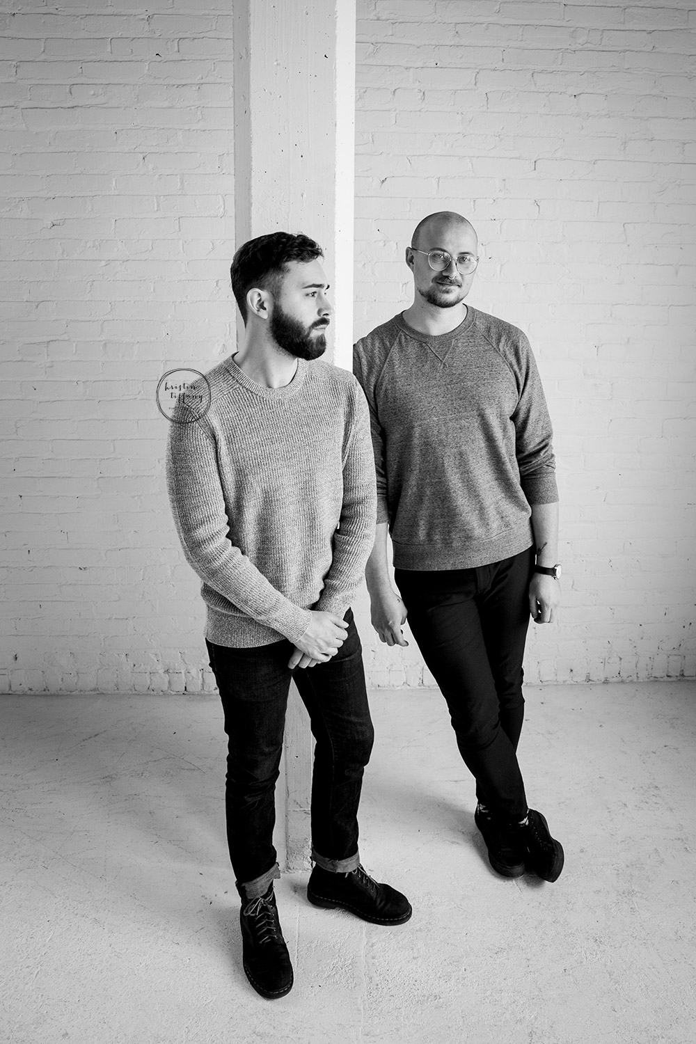 a photo of two men in an all white studio