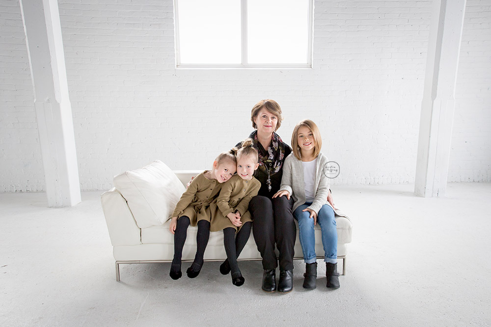 a photo of a grandma with her granddaughters