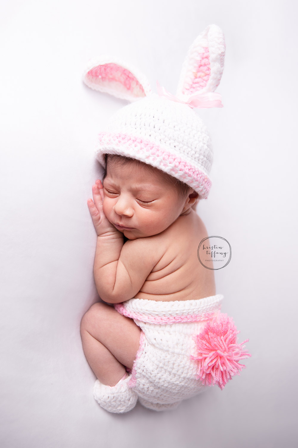 a photo of a baby girl in a bunny costume