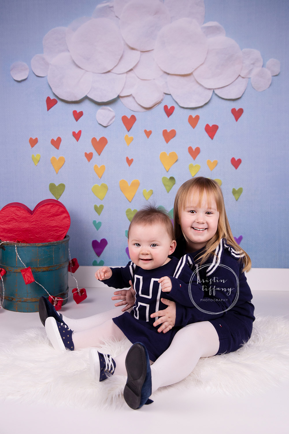 a photo of sisters at a valentines day photoshoot