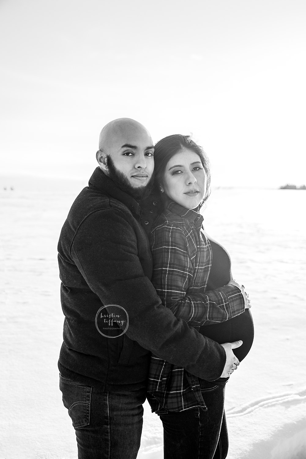 a maternity photo taken in the snow