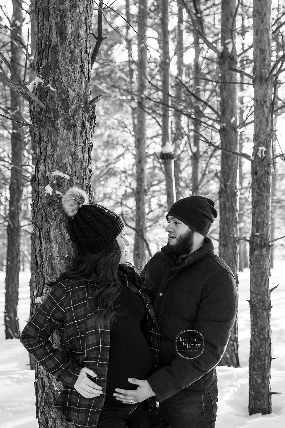 a maternity photo taken in the winter