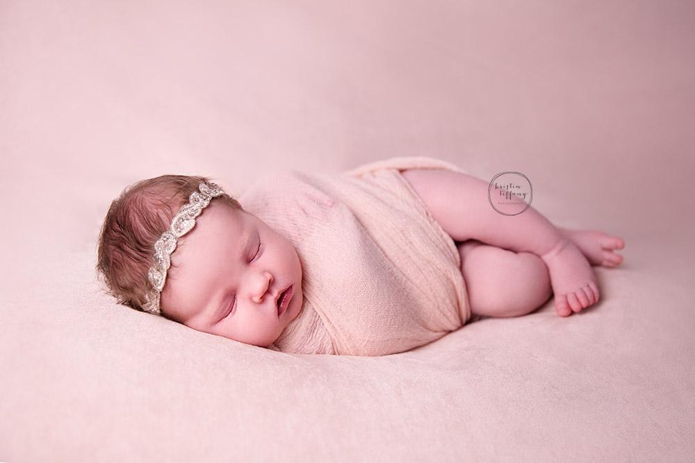 a photo of a newborn baby girl sleeping