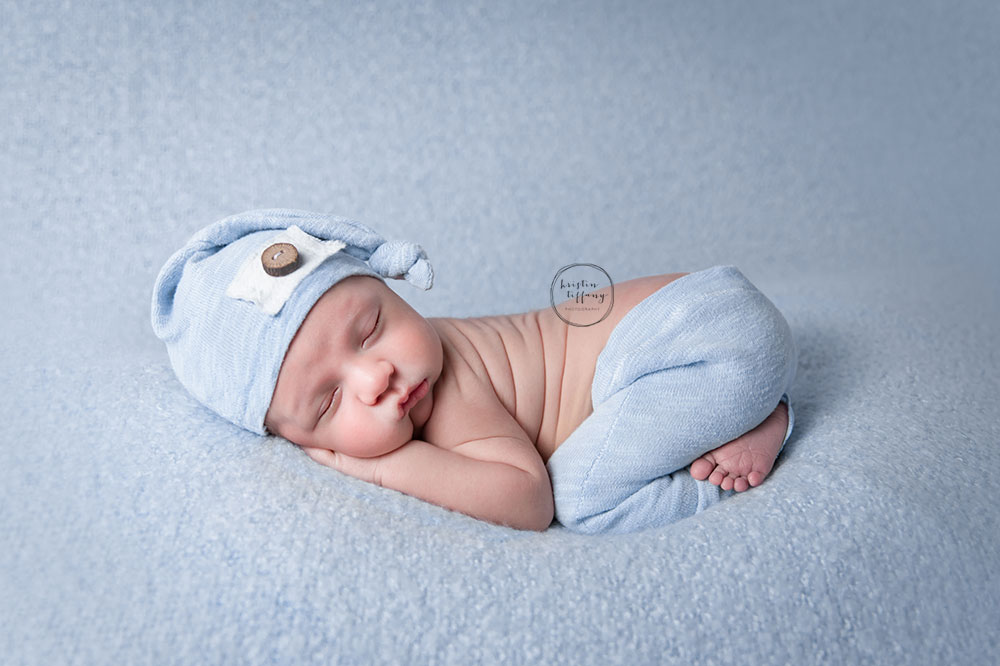 a posed newborn session of a baby boy