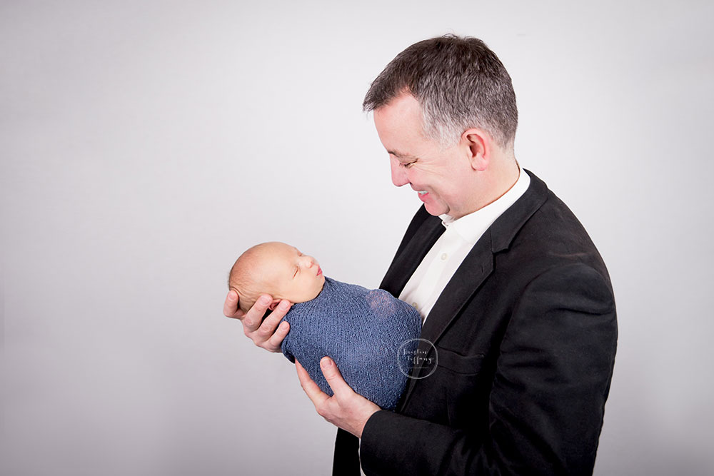 a posed newborn session of a baby boy and his dad