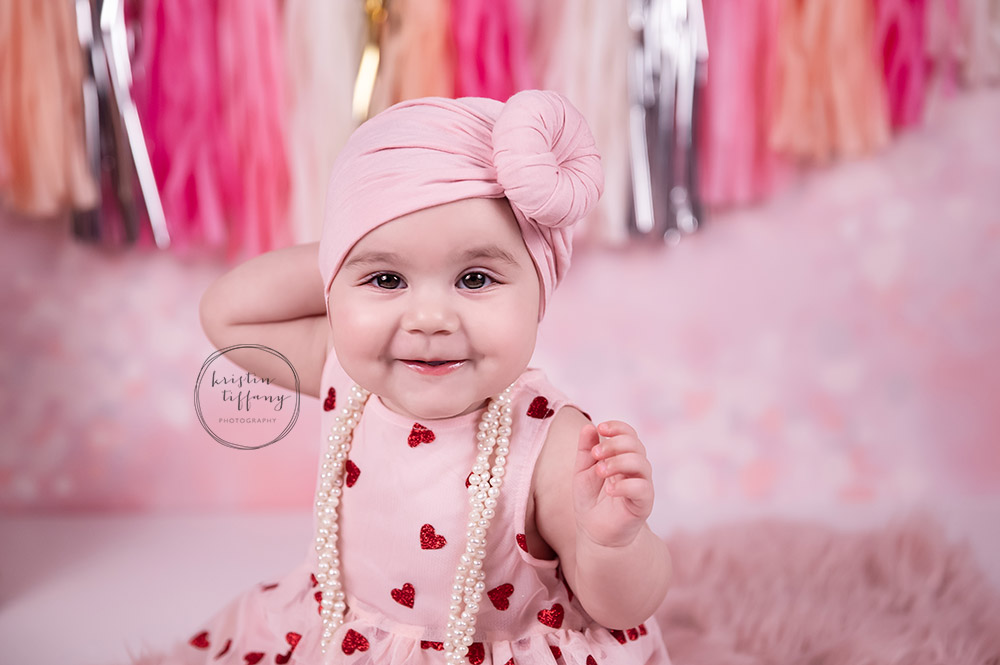 a photo of a baby girl at a valentines day photoshoot