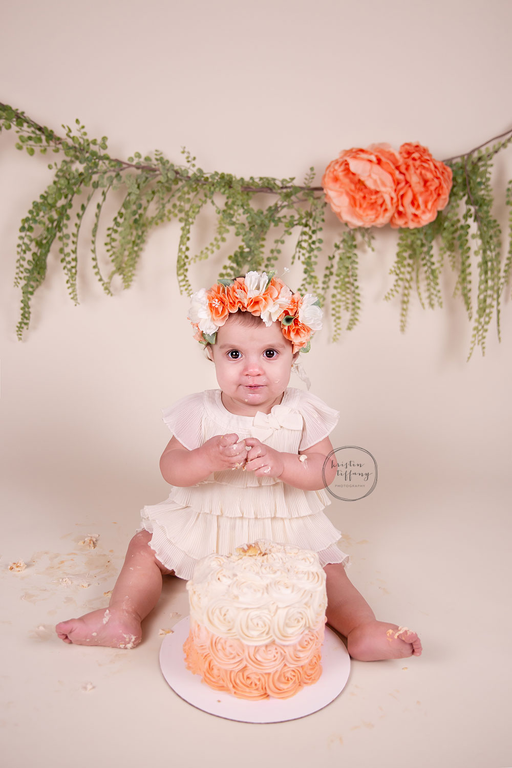 a photo of a baby girl at her cakesmash session