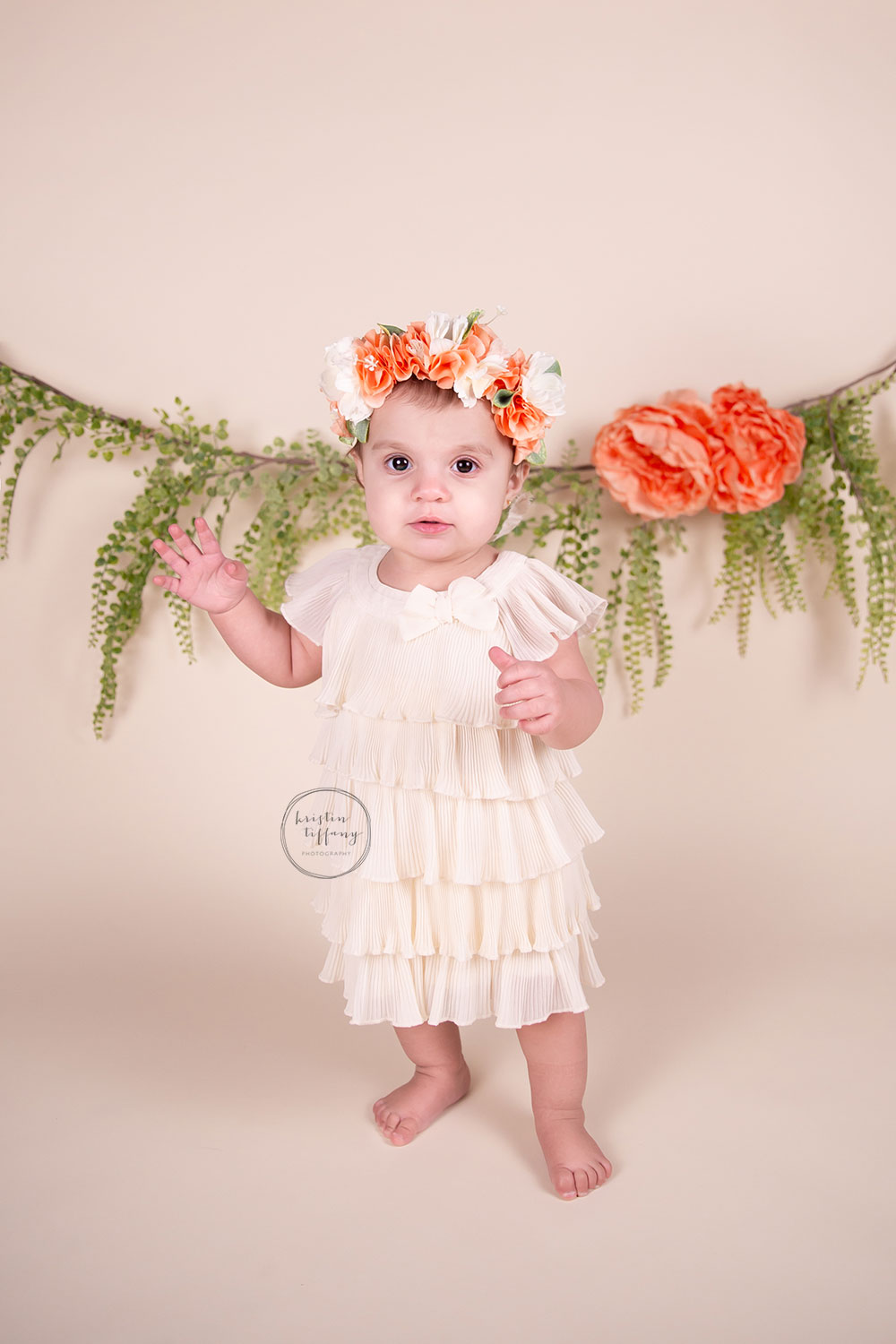 a photo of a baby girl at her first birthday photo shoot