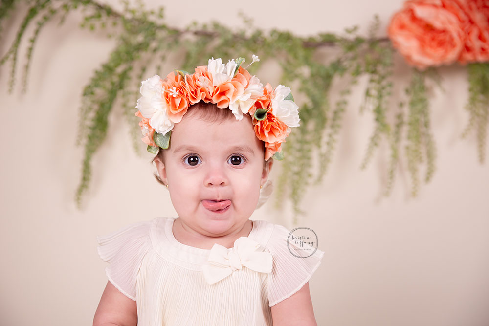a photo of a baby girl in a floral crown