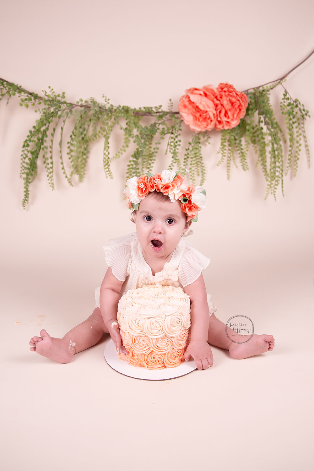 a photo of a baby girl hugging her birthday cake