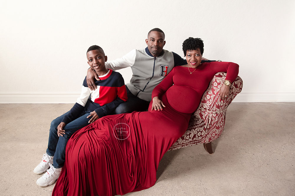 a maternity photo of a woman and her family
