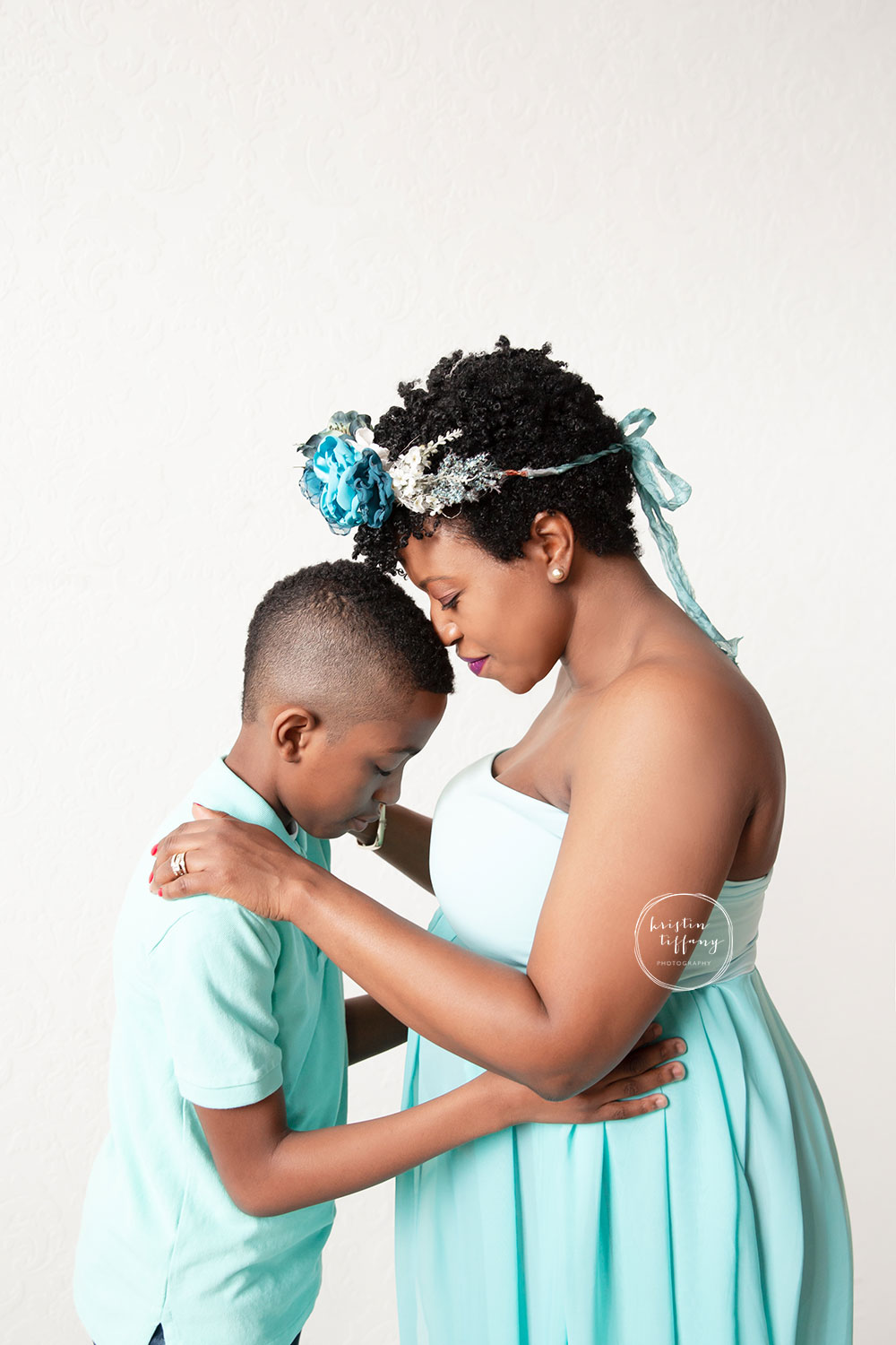 a maternity photo of a mother with her son