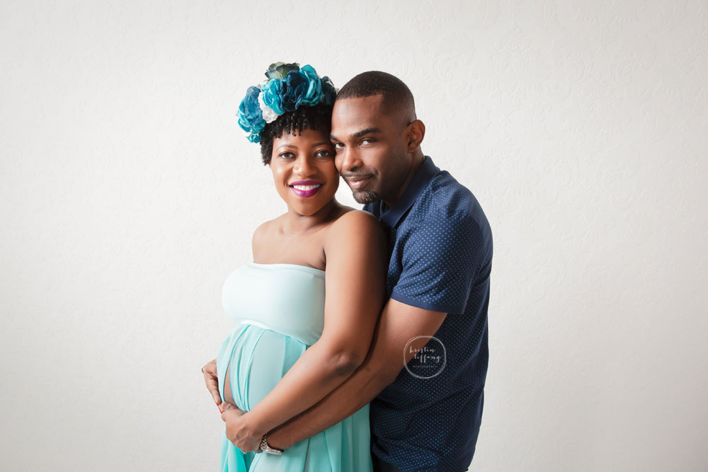 a maternity photo with a husband and wife