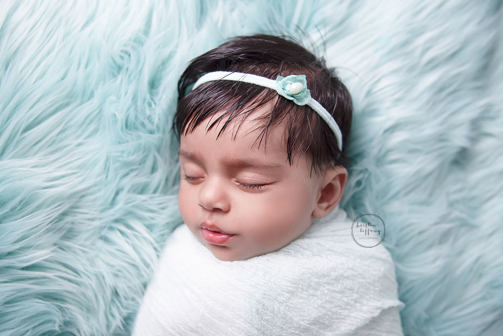 a photo of a baby girl sleeping at her photosession
