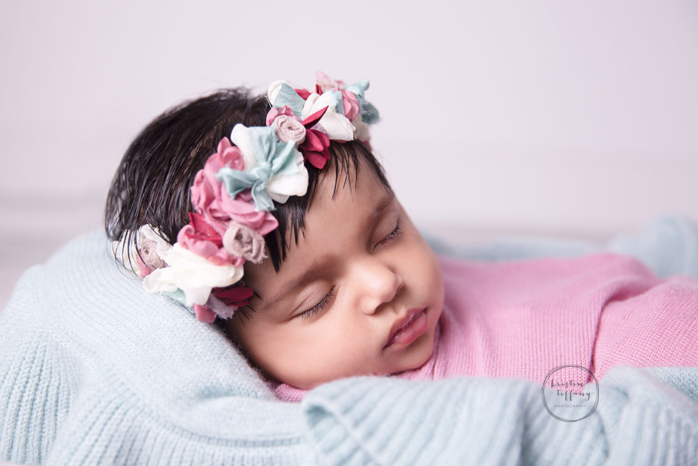 a photo of a sleeping baby girl at a baby photo session