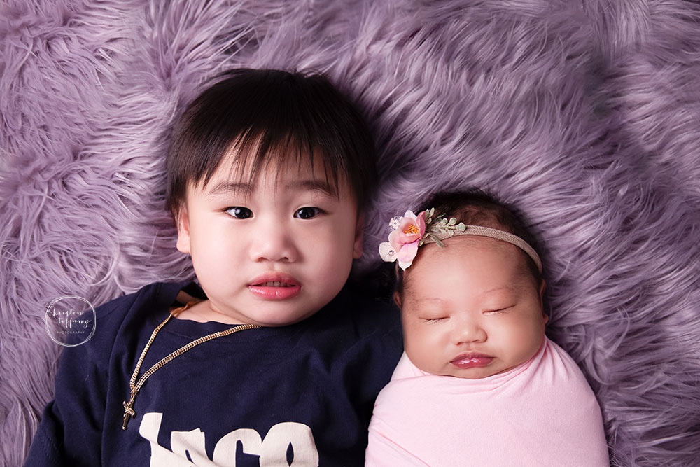 a photo of siblings at a newborn session