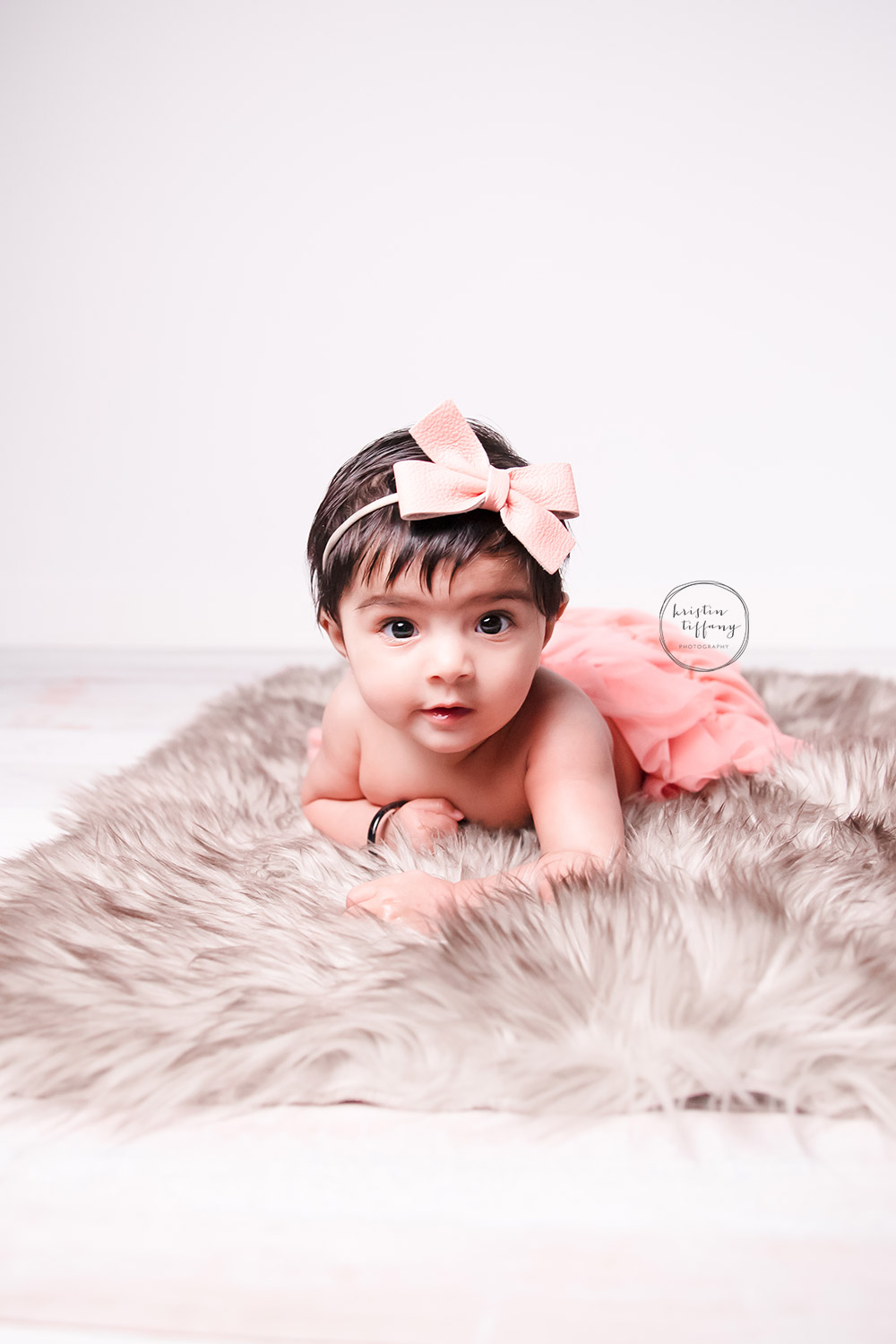 a photo of a baby girl at her photoshoot