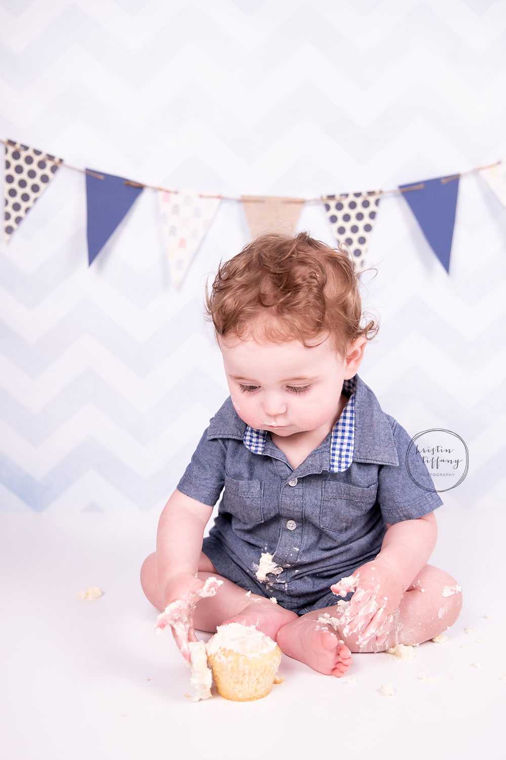 a photo of a baby smashing a cupcake