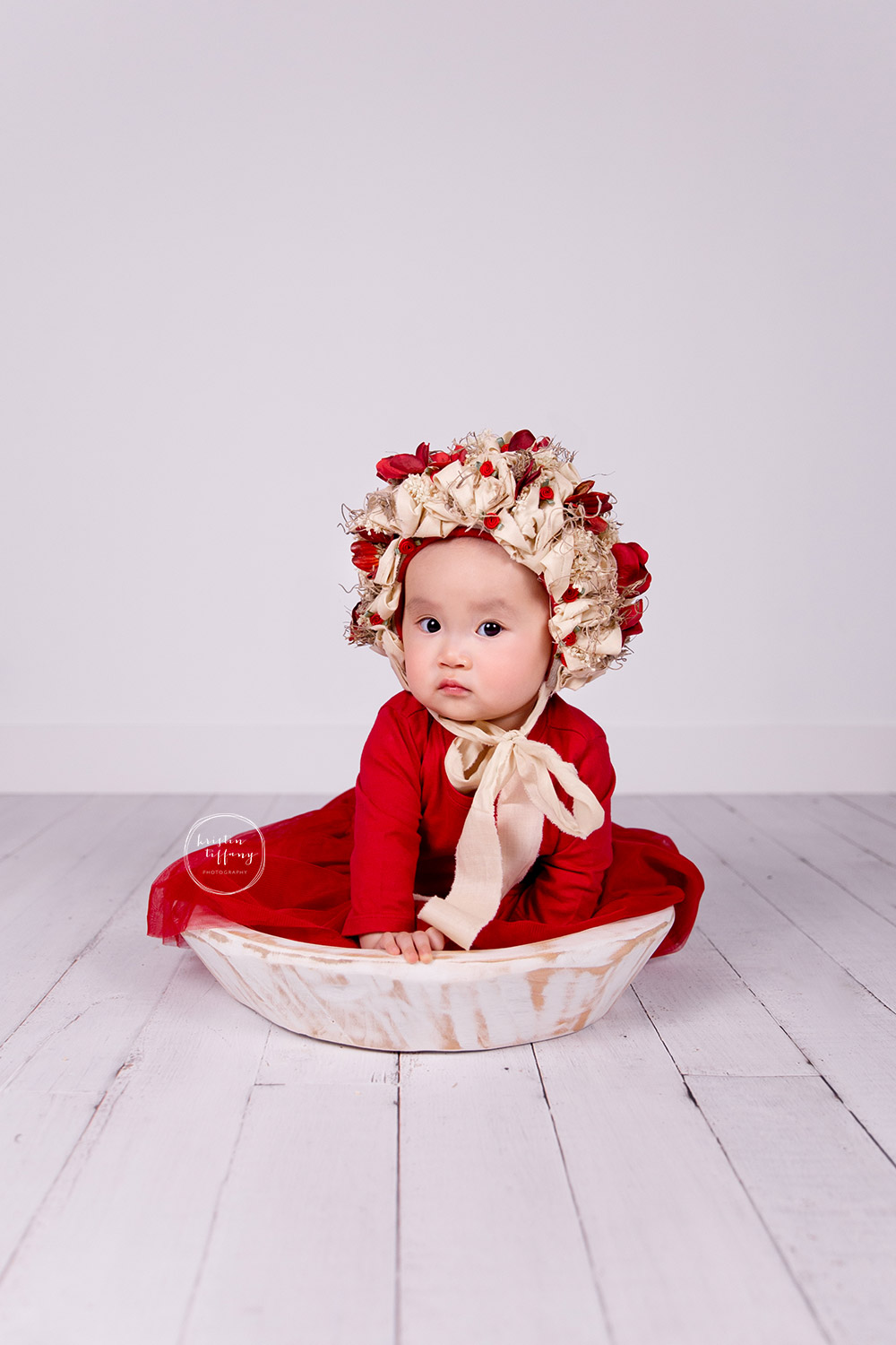 a photo of a baby girl in a floral bonnet