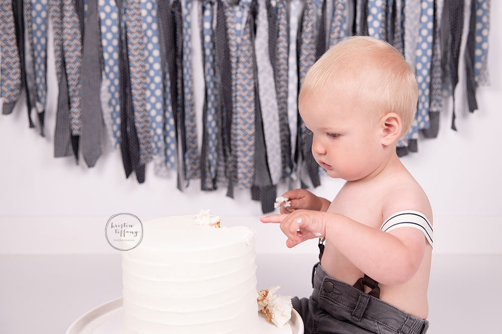 a photo of a baby boy at his cake smash photoshoot