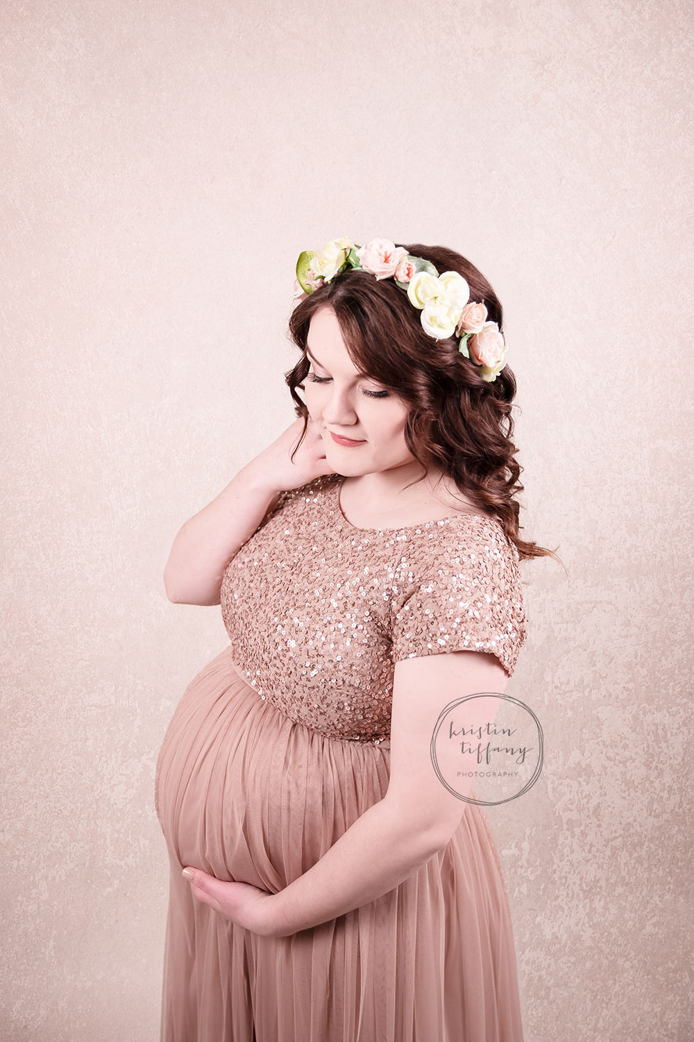 a maternity photo of a woman in a pretty dress