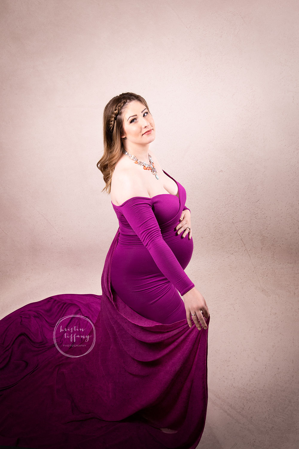 a photo of a pregnant woman at her maternity photo shoot