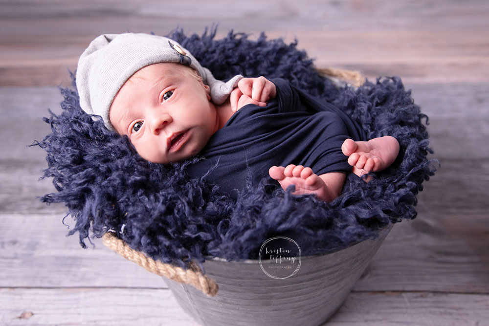 a photo of baby boy at his newborn photo session