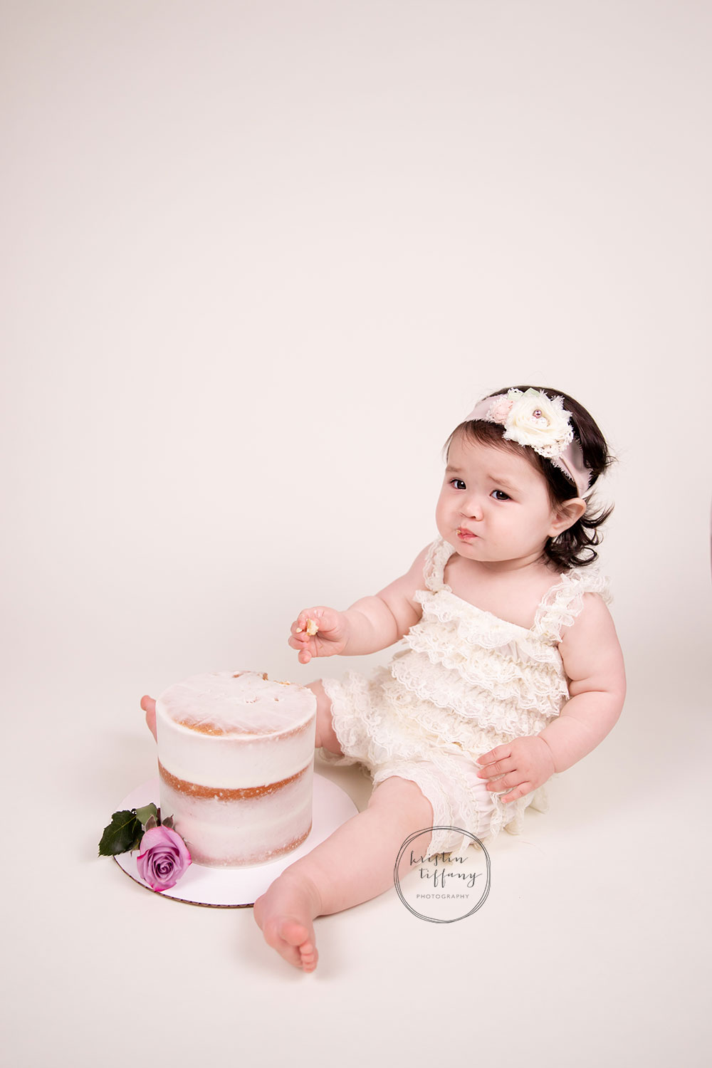 a photo of a baby girl at her cake smash photo session