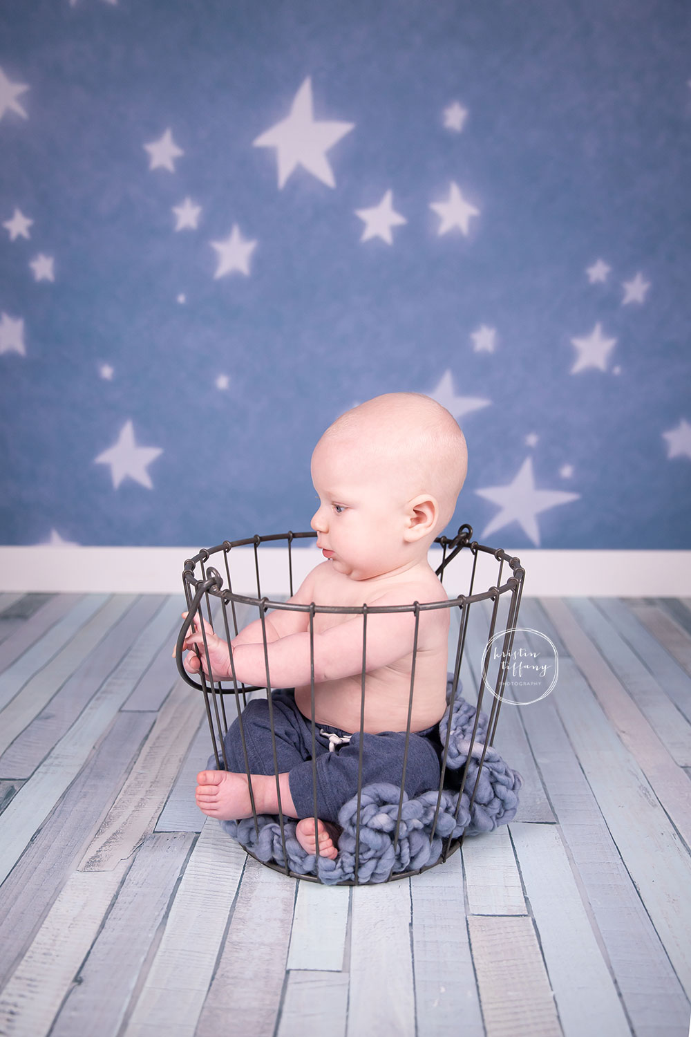 a photo of a baby boy at a sitter session photoshoot