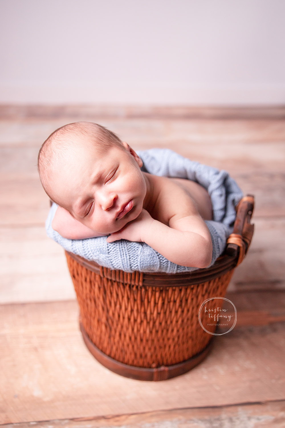 a photo of a newborn baby boy at his newborn photoshoot