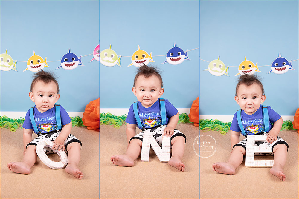 a photo of a baby boy at his baby shark photoshoot
