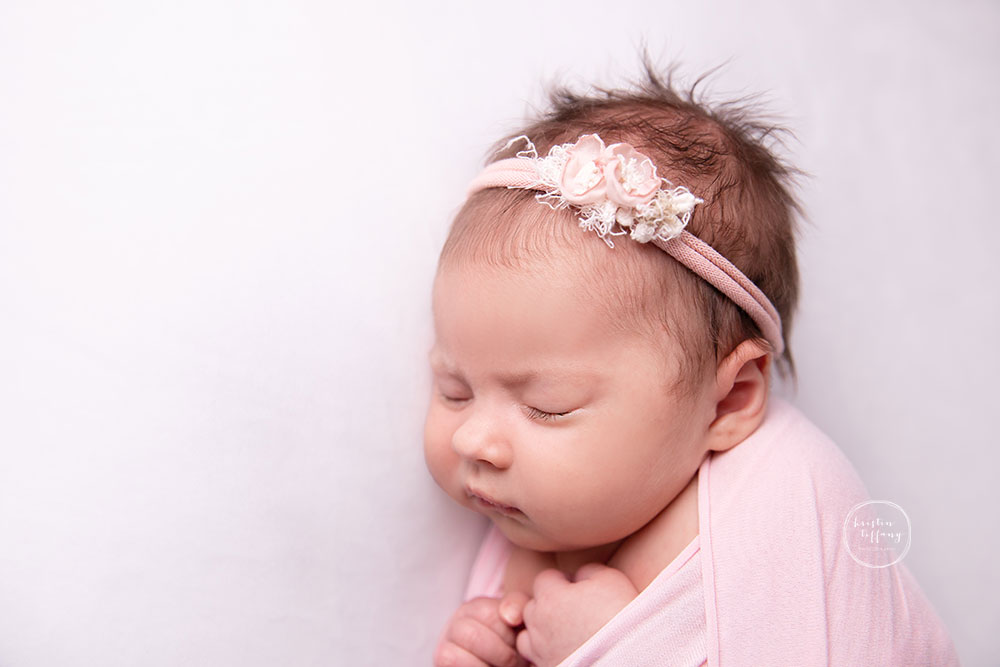 a photo of a baby girl at a baby photo session