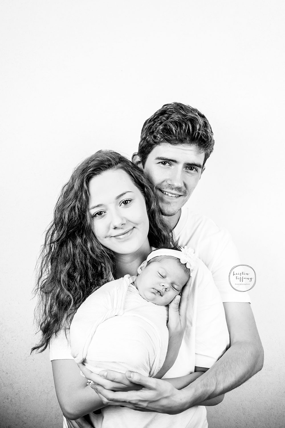 a photo of a baby girl and her family at a baby photo session