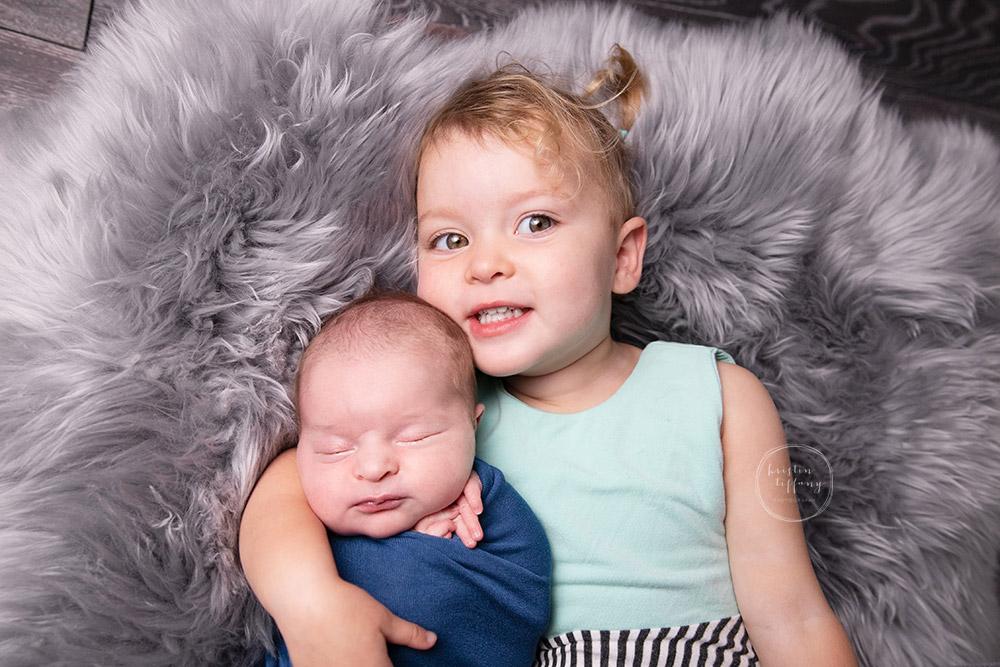 a photo of a newborn baby boy at a newborn photoshoot