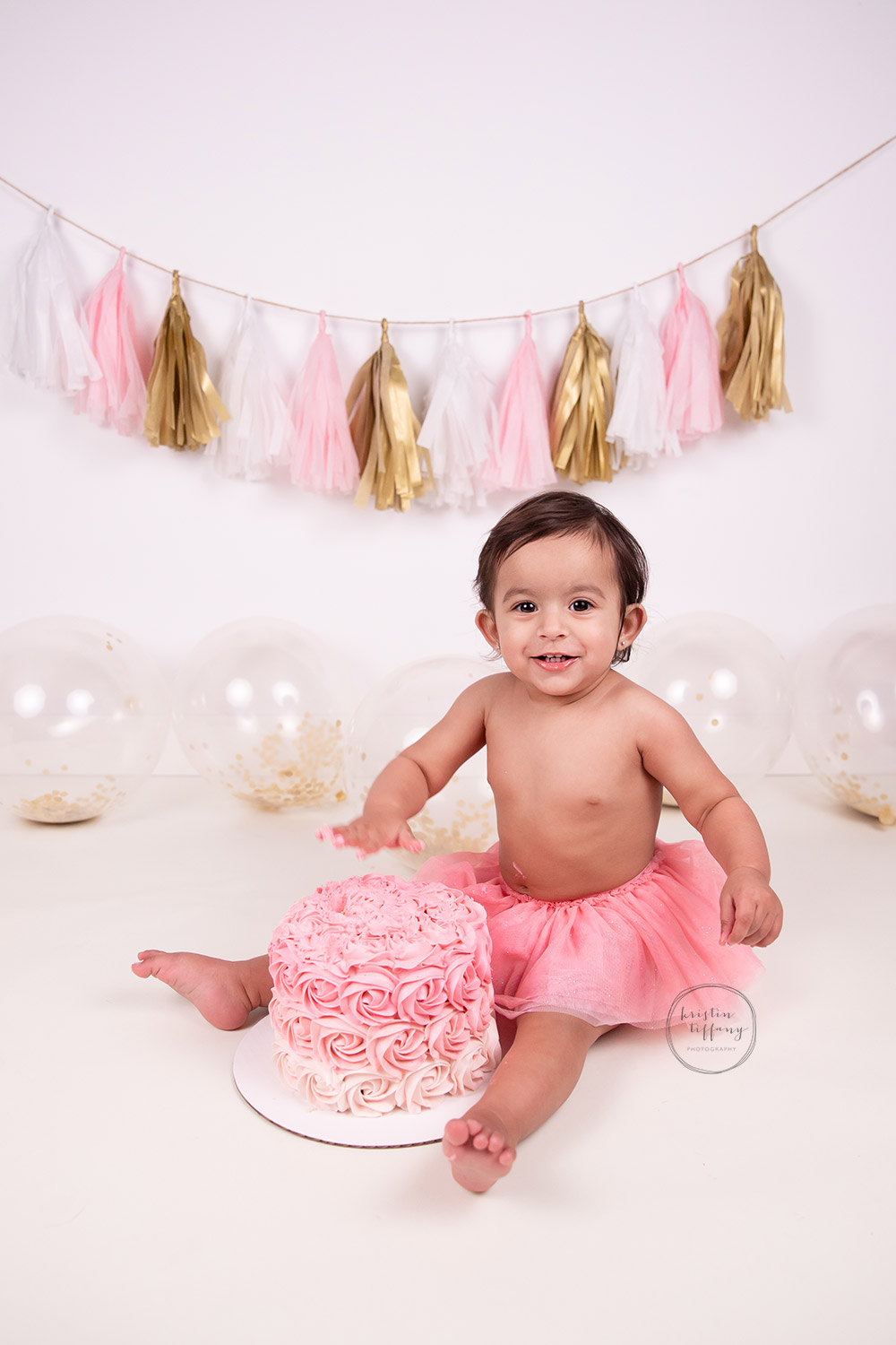 a photo of a baby girl at her cake smash session