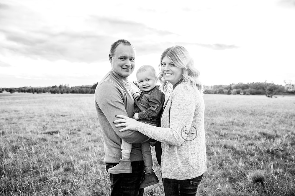 a photo of a family at an outdoor fall photo session