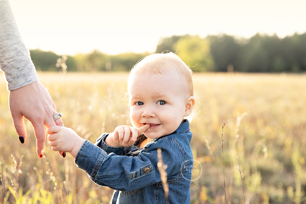a photo of a baby boy at an outdoor fall photo session